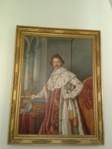 Ludwig I., einer der besten bayerischen Könige, war im persönlichen Umgang eher auf Sparsamkeit bedacht, doch für ein gscheides Gemälde muss man sich halt auch mal im Hermelin-Outfit präsentieren.